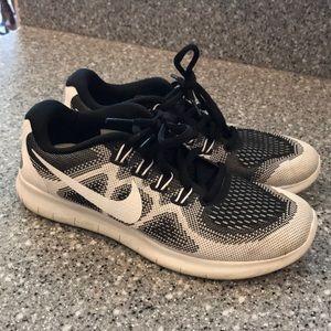 Black and white Nike Free RN